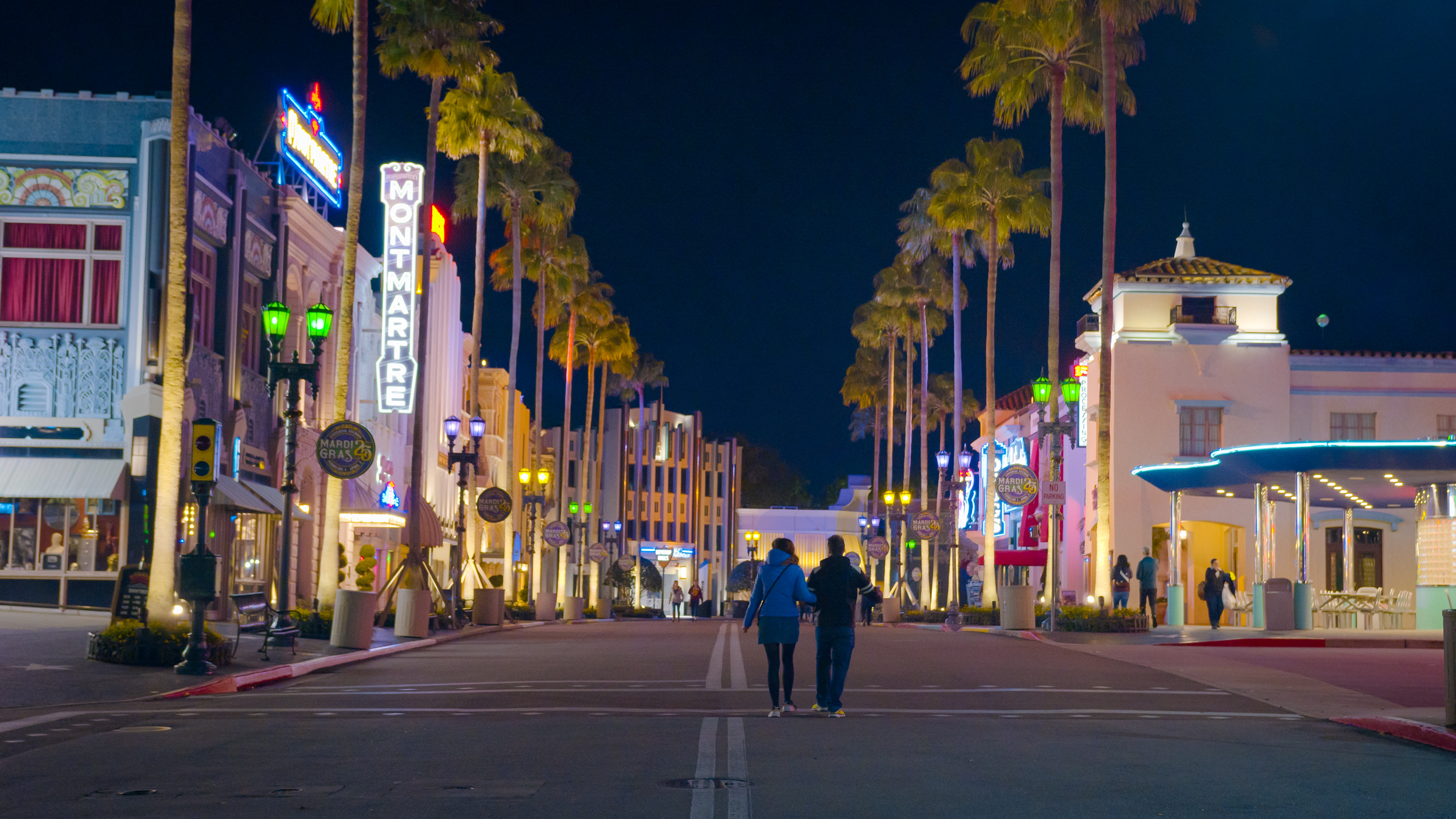 Couple walking down an empty Hollywood Boulevard in Universal Studios Florida